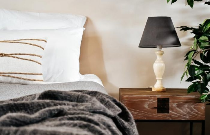 bedside table, lamp and bed at the spa cottage